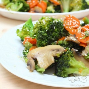 A dish of mushrooms and broccoli